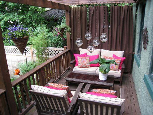 Hanging Plants and Candles on Brown Wood Patio