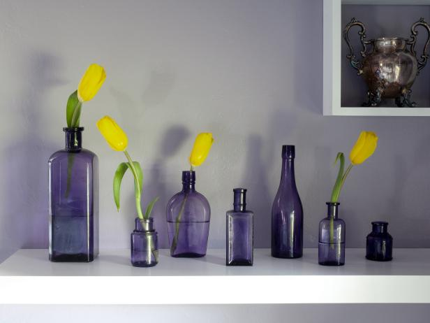 Floating Shelf with Purple Bottles with Yellow Flowers
