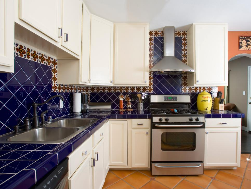 Traditional White Kitchen with Mediterranean Blue Tile