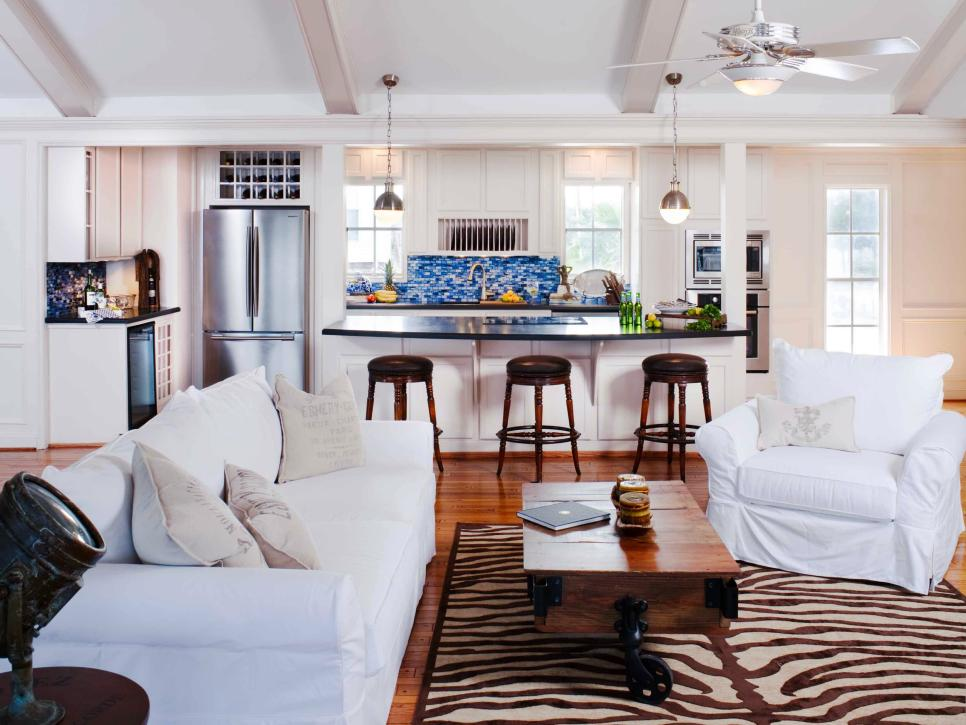 White Open Kitchen and Living Room With Zebra Print Rug