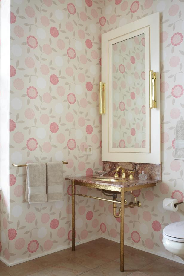 Bathroom With Pink and White Floral Wallpaper and Gold Washstand
