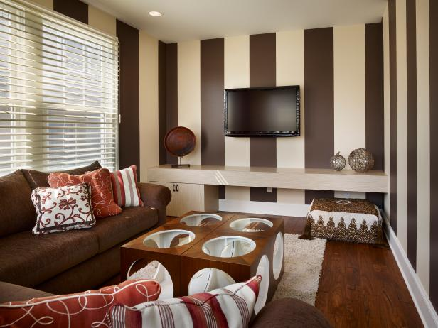 TV Room With Brown and Cream Striped Wallpaper and Cube Tables