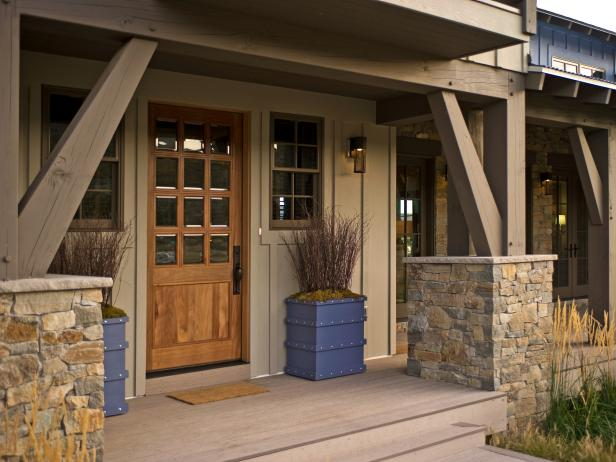 Ranch Home Exterior With Stone Pillars, Wood Door and Planter Boxes
