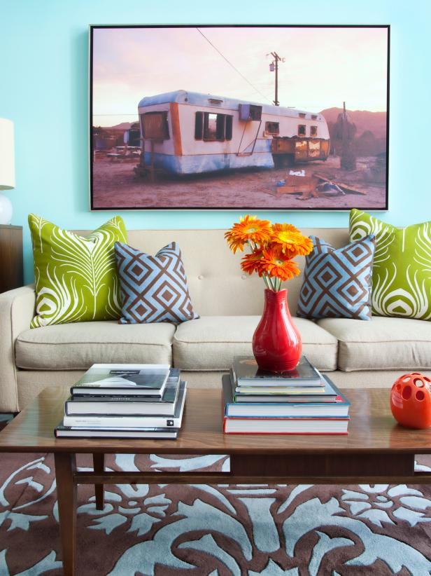 Contemporary Living Room With Turquoise Walls and Colorful Pillows