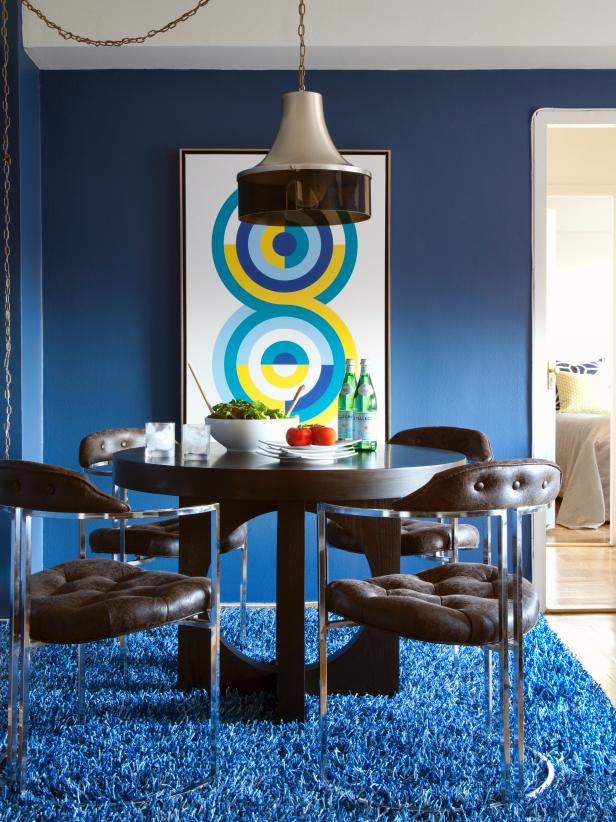 Contemporary Dining Room With Dark Wood Table And Blue