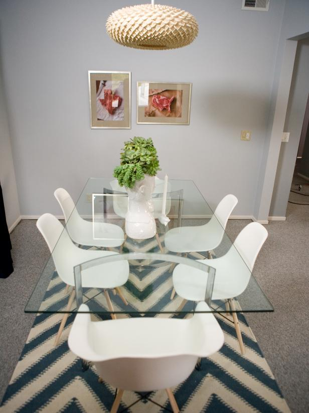 Gray Dining Room With Chevron Rug, Glass-Top Table, White Chairs