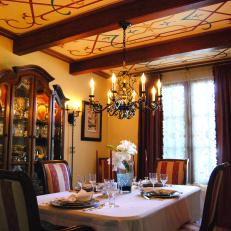 Painted Ceiling And Wood Beams In A Traditional Dining Room