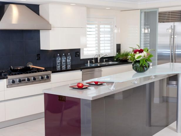 Modern Black and White Kitchen with Red and Gray Island