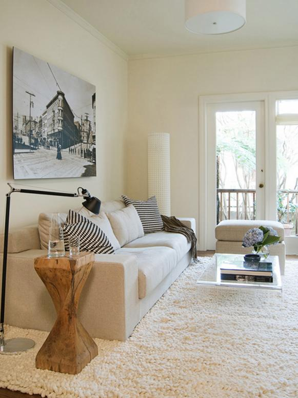 Contemporary White Living Room With Clear Coffee Table