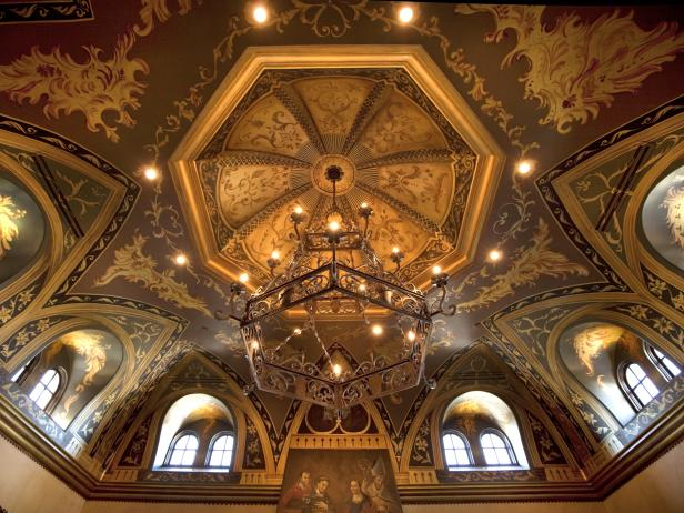 Dome Ceiling With Recessed Lighting and Chandelier