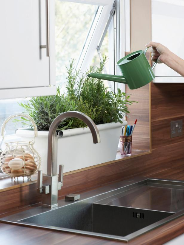Watering a Kitchen Herb Garden