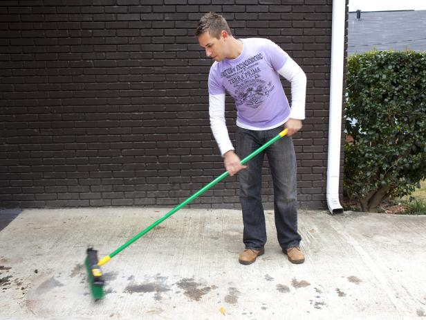 The first step in power washing a driveway is to clear debris and excess dirt or dust from its surface using a broom.  This also prevents any loose material, such as small stones, to interfere with the pressure washer.