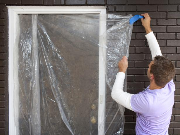 Protect Home's Exterior with Plastic Before Power Washing Driveway