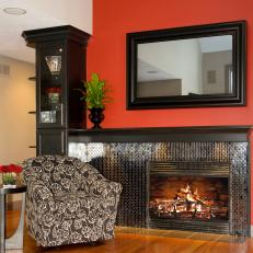 Black Mosaic Tile Fireplace on a Red Wall