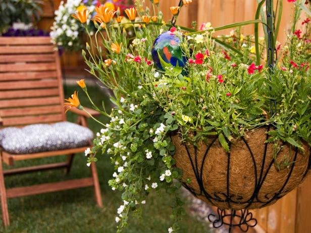 How to Plant Hanging Baskets | HGTV Easy Container Gardening Design Ideas Html on easy permaculture ideas, easy travel ideas, easy composting ideas, easy landscaping ideas, easy diy ideas, easy topiary ideas, easy christmas ideas, easy spring ideas, easy container plant ideas, easy entertaining ideas, easy container flower gardening, easy food ideas, easy garden, easy woodworking ideas, easy fall ideas, easy flower gardening ideas, flowers for flower pots ideas, easy sewing ideas, easy recycling ideas, easy xeriscaping ideas,
