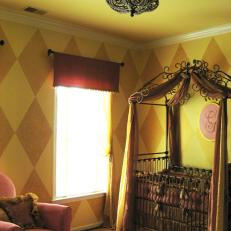 Princess Nursery With Canopy Crib and Pink Armchair
