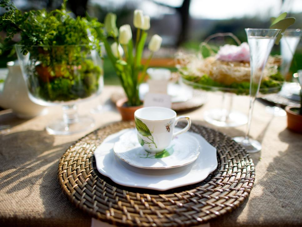 Table Setting With White Dishes, Brown Place Mats and White Tulips