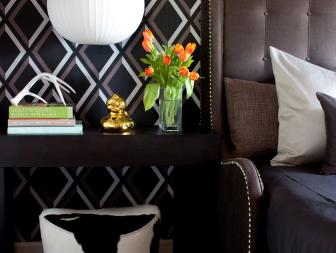 A Contemporary Side Table and Bold Wallpaper in Bedroom