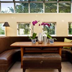 Bright, Inviting Dining Room With Banquette Seating