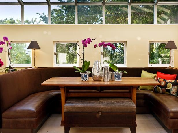 Dining Room With Leather Banquette and Wall of Windows