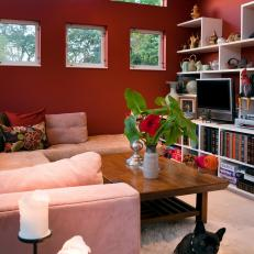 Cozy Red Living Room with White Shelving and Cozy Sectional