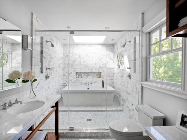 Enclosed Glass Shower And Tub In A Luxurious White And Gray Bathroom