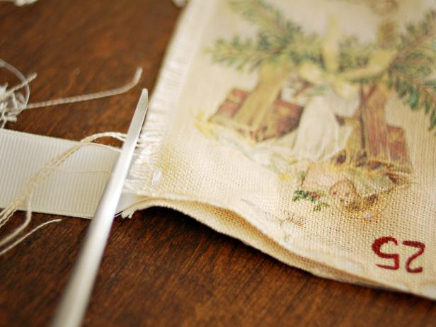 Trim excess threads. Apply no-fray glue to raw edges of ribbon and allow to dry. Fill the pockets with candy and small presents to build the anticipation of Christmas day. Tip: This advent calendar can be used in a variety of ways.