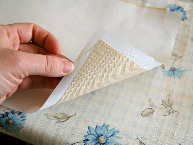 Press paper onto fabric using an iron set on high until they are fused.