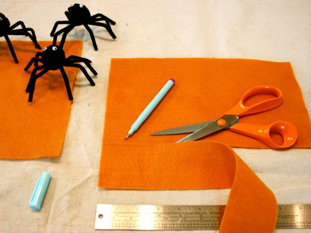 Cut strips of orange fabric to make Halloween napkin rings.