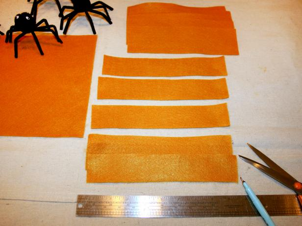 Fun Halloween napkin rings can be made from orange felt.