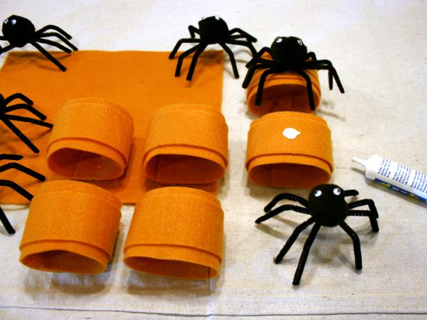 Attach spooky spiders to fun Halloween themed napkin rings.