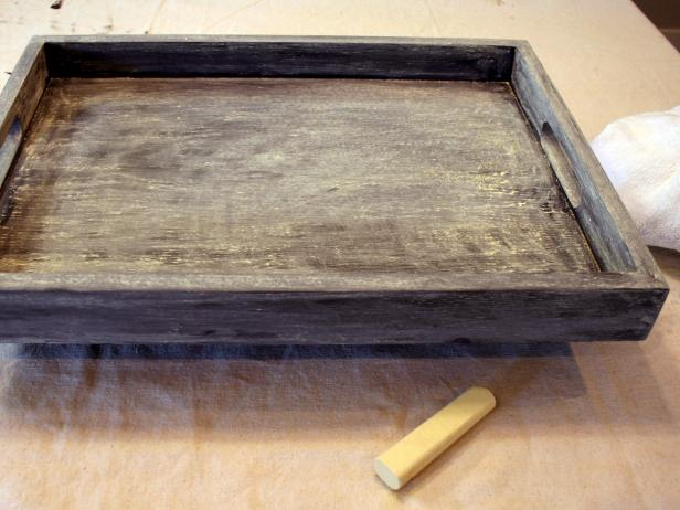 Prepare tray for writing by covering surfaces using a large chalk stick on its side. This allows all future markings to be fully erasable.