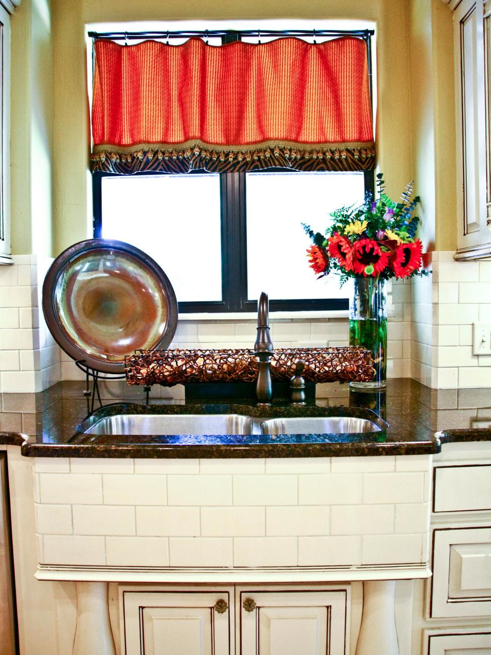Neutral Kitchen With White Subway Tile and Red Valance
