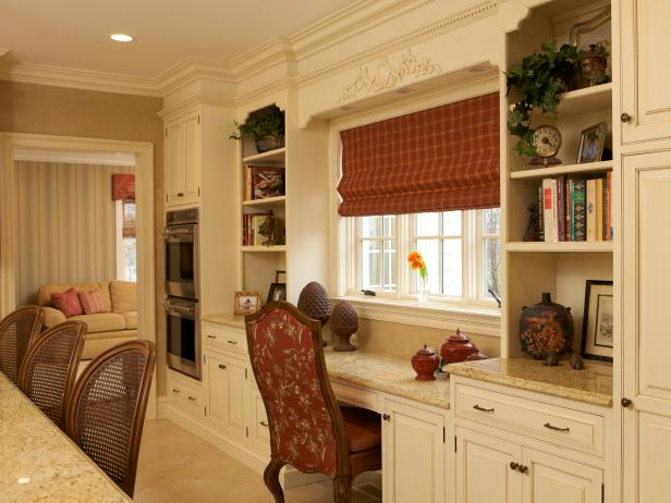 White Kitchen Desk Area With Red Cushioned Chair and Bookshelves