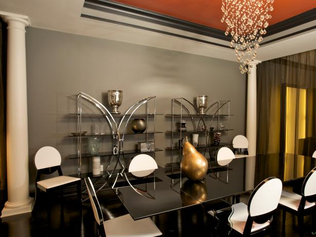 Modern Gray Dining Room With Chandelier and Orange Ceiling