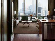 A warm and inviting entrance capitalizes on the apartment's outstanding views of Chicago's skyline.