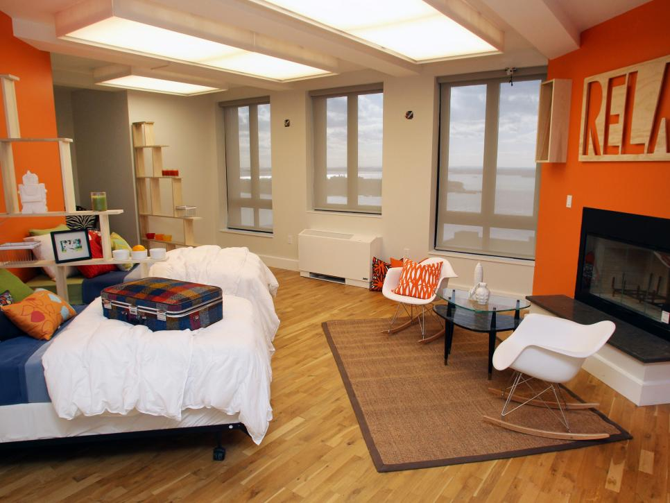 Orange Multi-Bed Room With Fireplace & Modern Rocking Chair