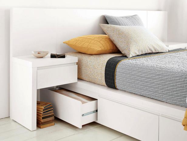 Platform bed offers six storage drawers.