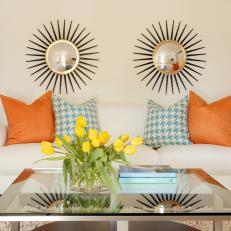 Tropical-Inspired Living Room With Sunburst Mirrors