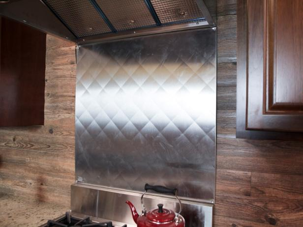 Stainless Steel Backsplash and Wood Wall in Farmhouse Kitchen