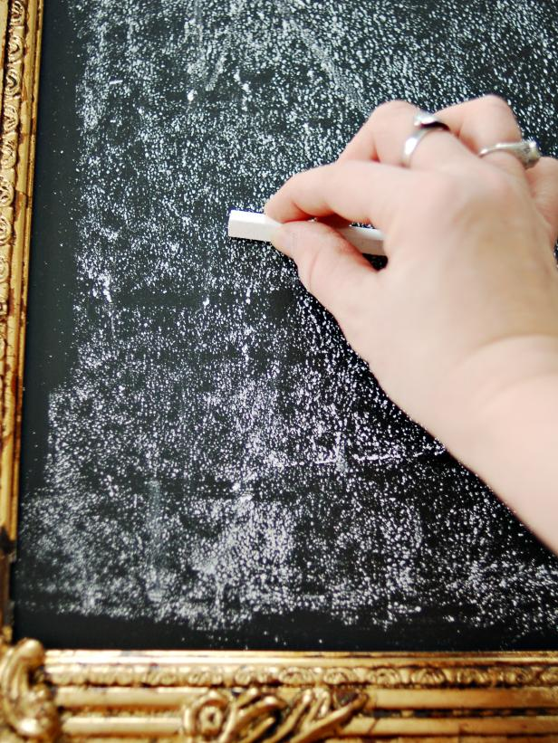 Rub entire chalkboard with the side of a piece of chalk. This will season the chalkboard and prevent writing from being burned into the surface. Erase chalkboard with a wet paper towel for a clean look or with a dry one for a smeared, vintage look.