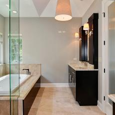 Contemporary Bathroom with Dark Cabinets and Soaking Tub