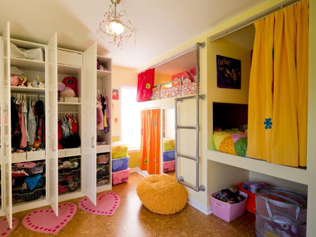 Creative shared bedroom for three girls hgtv - Childrens small bedroom furniture solutions ...