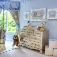Sweet Blue Nursery With Gold Changing Table