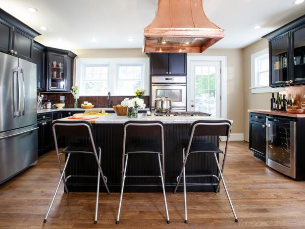 Transitional Kitchen With Black Island and Cabinetry