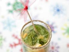 The best part of this drink is the edible glitter rim. Sweet citrus and tasty mint pair perfectly in this festive party cocktail.