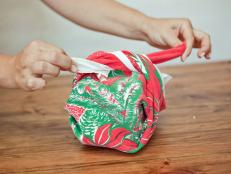 Bring retro holiday patterns to your party with dish towel favors made from vintage Christmas tablecloths.