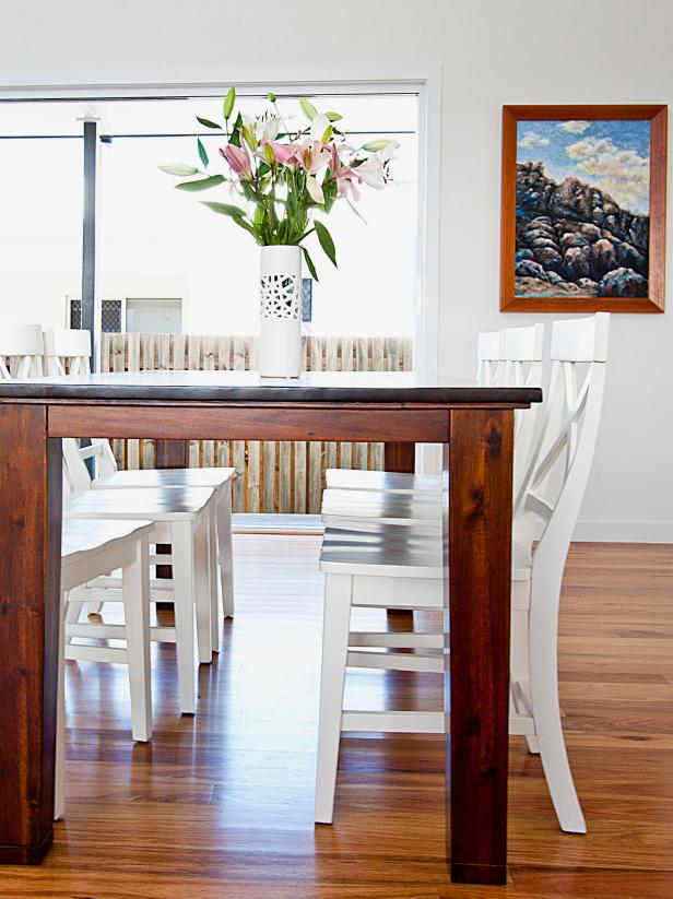 Contemporary Coastal Dining Room With Hardwood Dining Table & White Chairs