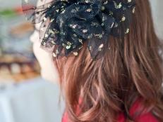 Every hostess needs a party-perfect hairpiece, like this black-and-gold tulle accent. Add vintage flair to your holiday party outfit, or make a big batch to give as wearable favors.