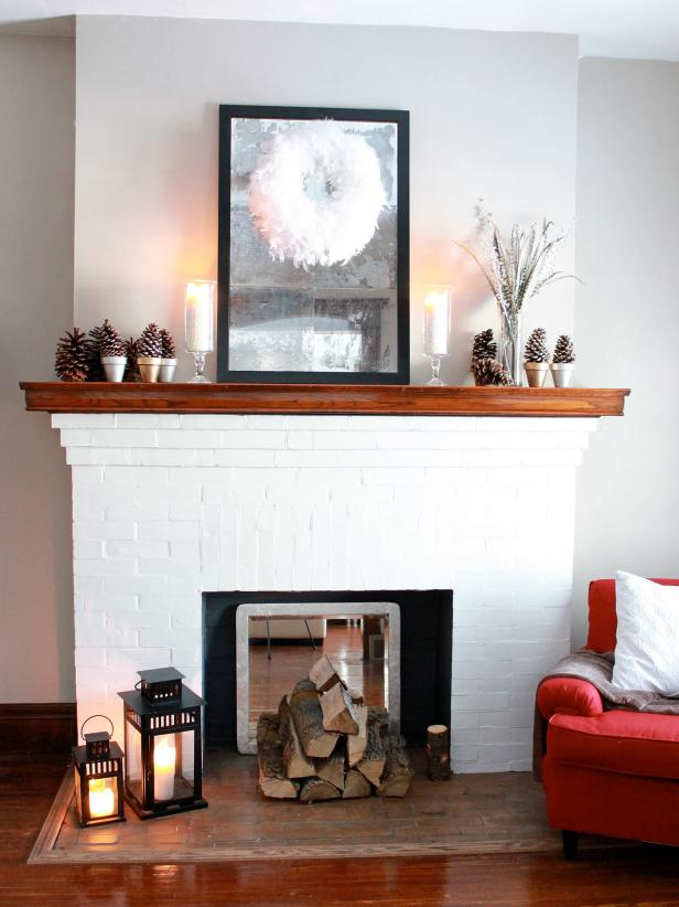 Fireplace Mantle with Artwork, Candles and Pinecones